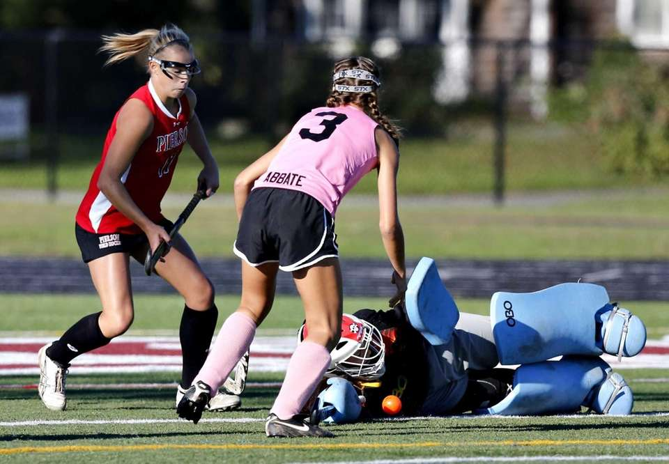 Pierson goalie Emma Romeo goes down for the