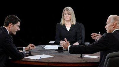 Moderator Martha Raddatz watches as Vice President Joe