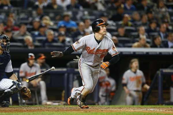 Baltimore Orioles outfielder Nate McLouth watches the flight