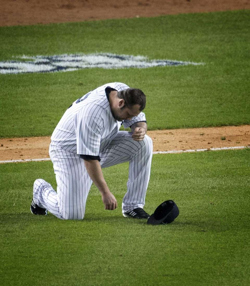 Yankees pitcher Joba Chamberlain is struck with a