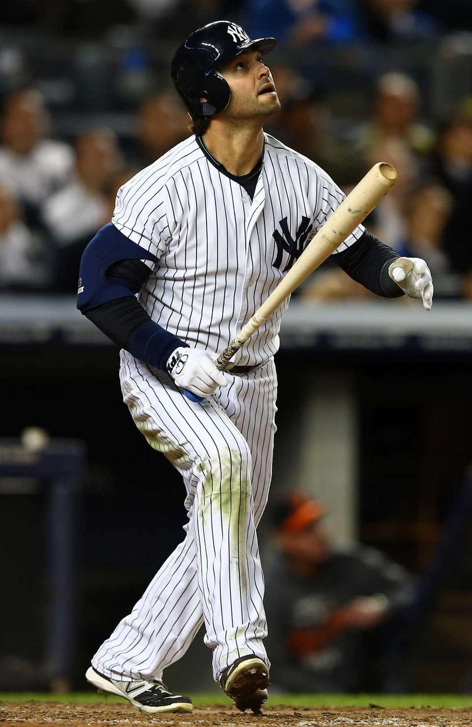 Nick Swisher hits a pop fly during Game