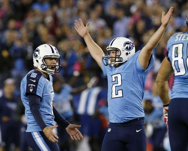 Tennessee Titans kicker Rob Bironas reacts with holder
