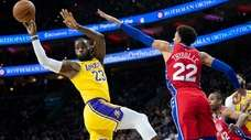 Los Angeles Lakers' LeBron James, left, passes the