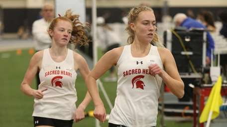 Sacred Heart's Maggie Maier leads the 1,500-meter run