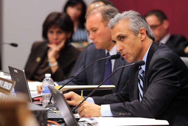 Suffolk County Legislator Lou D'Amaro asks questions to