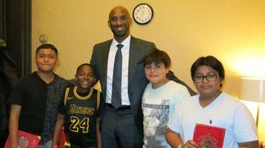 Retired NBA star Kobe Bryant with Kidsday reporters