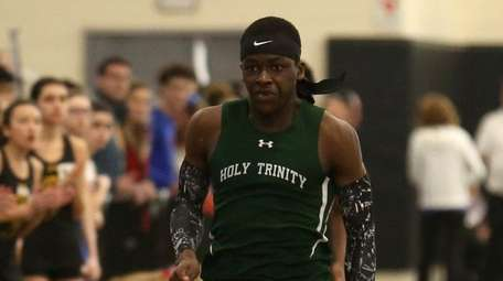 Holy Trinity's Chris Holt wins the boys 300-meter