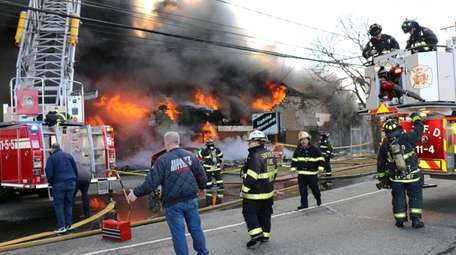 Firefighters from multiple area departments battle a commercial