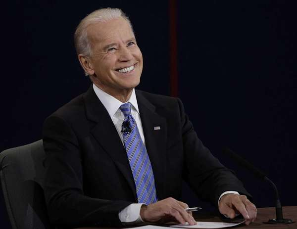 Vice President Joe Biden smiles after hearing a