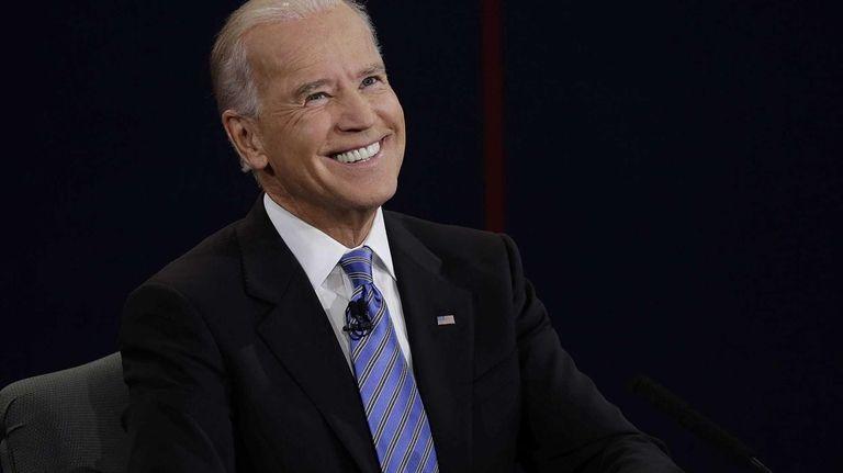 Vice President Joe Biden smiles after hearing a