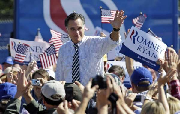 Republican presidential candidate, former Gov. Mitt Romney waves