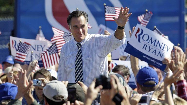 Republican presidential candidate, former Gov. Mitt Romney waves