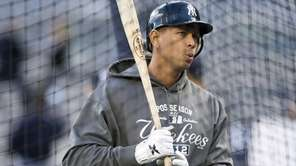 Alex Rodriguez warms up for batting practice before