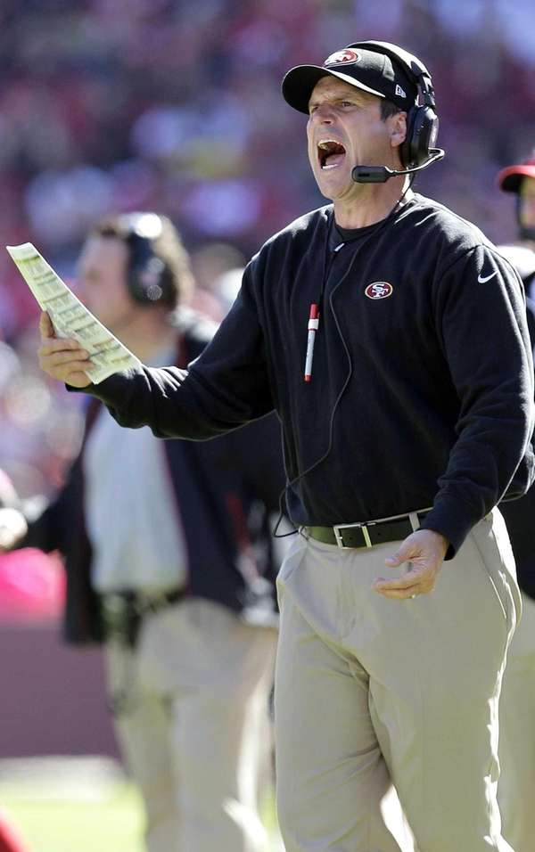San Francisco 49ers head coach Jim Harbaugh yells