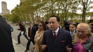 Former state Senator Pedro Espada makes his way