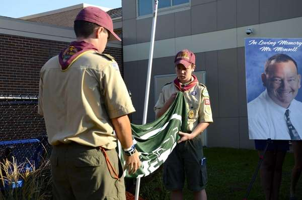 Two members of Boy Scout Troop 329 fold