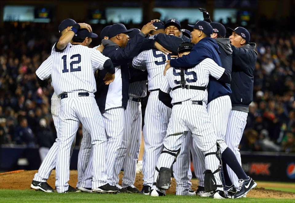 The New York Yankees celebrate after defeating the