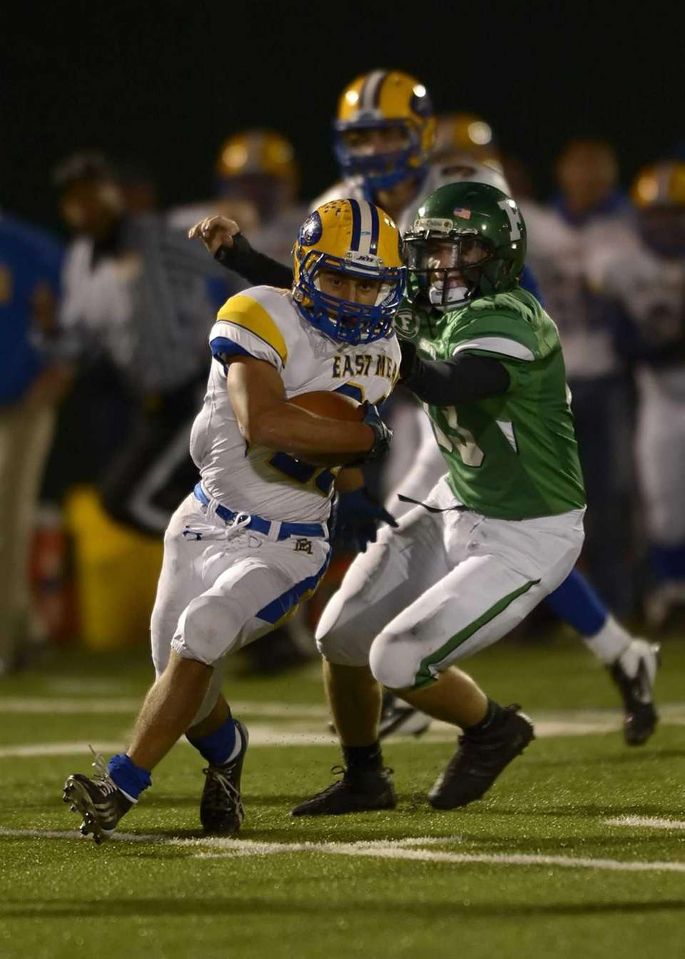 East Meadow's Jack Ridder (28) spins through the