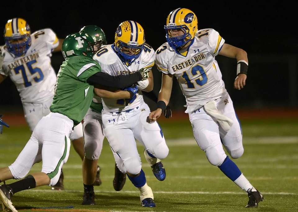 East Meadow's Billy Andrie with quarterback Chris Buschi