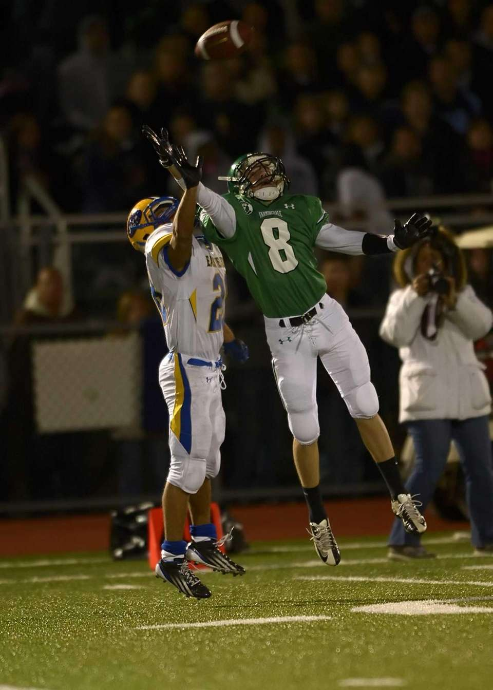 Farmingdale's Tom Kennedy goes up for the pass