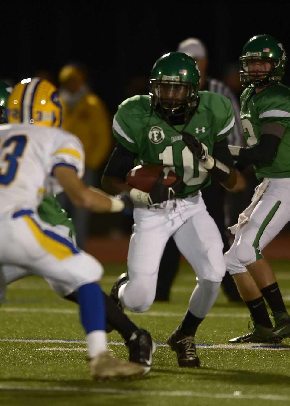 Farmingdale's Curtis Jenkins breaks through the East Meadow