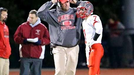 Connetquot quarterback Brian McKean gets a play from