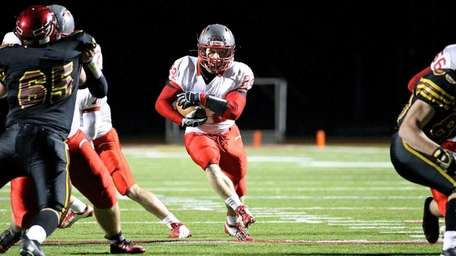 Connetquot running back Ryan Harvey finds the hole