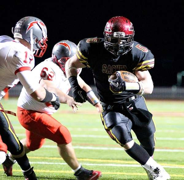 Sachem East running back Steve Casali powers into