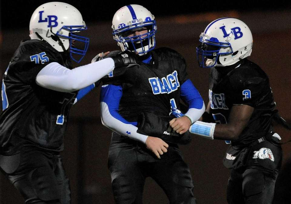 Long Beach's running back James Forkin, center, gets