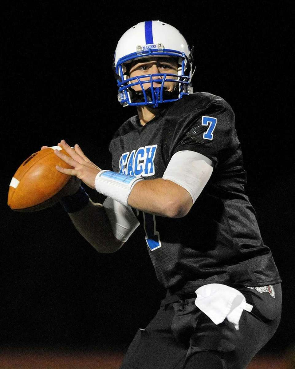 Long Beach High School quarterback Adam Salvadori throws