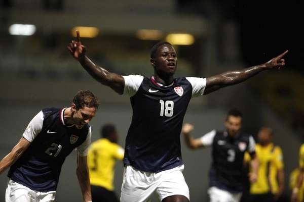Eddie Johnson, center, celebrates after scoring against Antigua