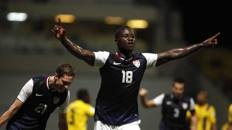 Eddie Johnson, center, celebrates after scoring against Antigua