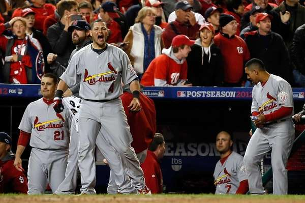 St. Louis Cardinals catcher Yadier Molina reacts in