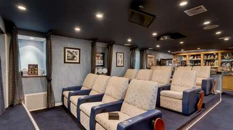 There is a home theater with three rows
