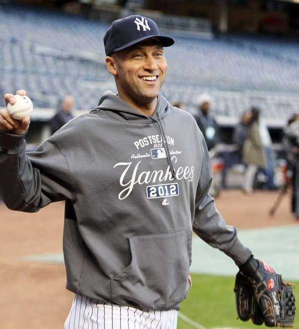 Derek Jeter of the New York Yankees warms