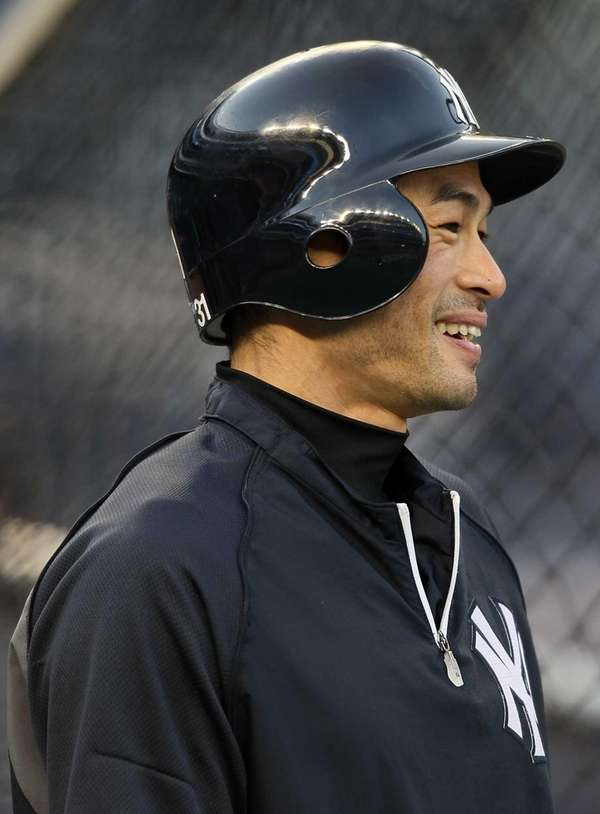 Ichiro Suzuki looks on during batting practice before