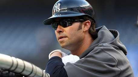 Nick Swisher looks on during batting practice against