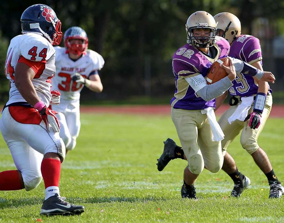 Sayville quarterback Zach Sirico scambles out of the