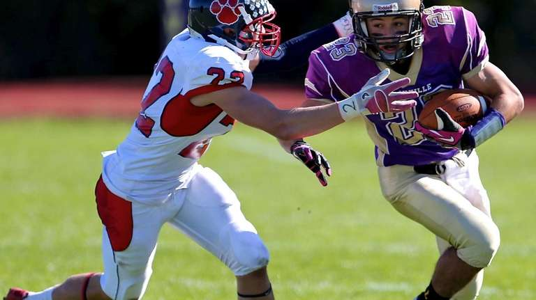 Sayville receiver James Giattino takes the pass and