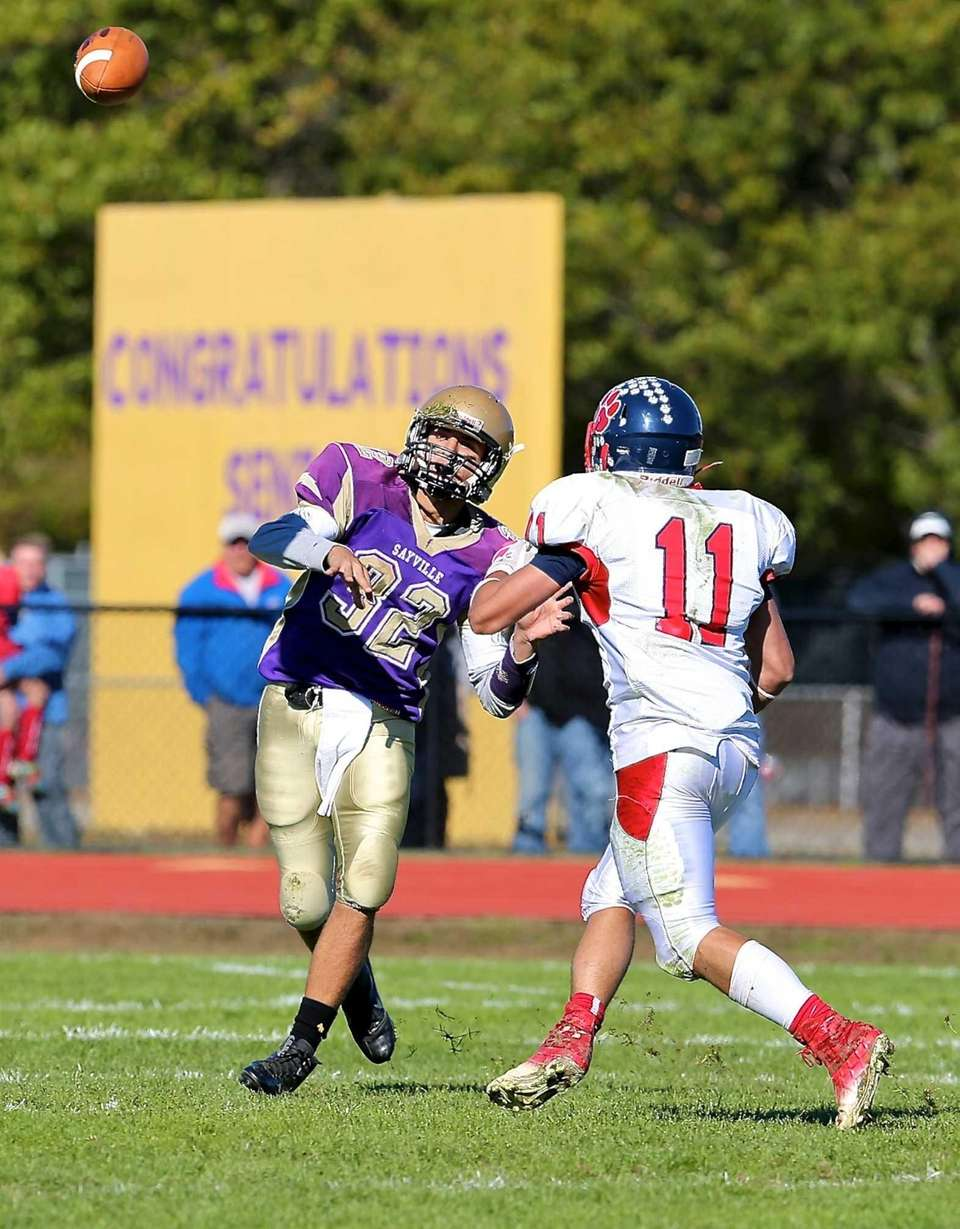 Sayville quarterback Zach Sirico gets the pass off
