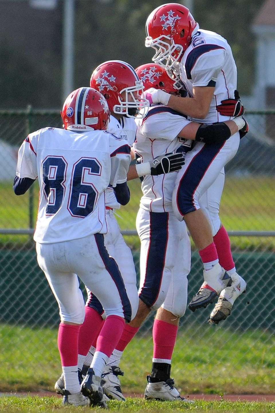 MAcArthur's Ryan Walsh, right, leaps into the arms