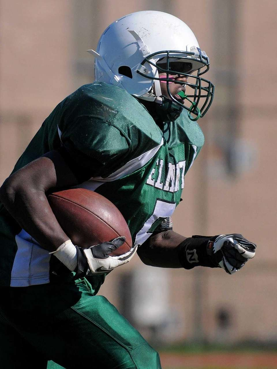Elmont's Calvin Aristide returns a kick in the