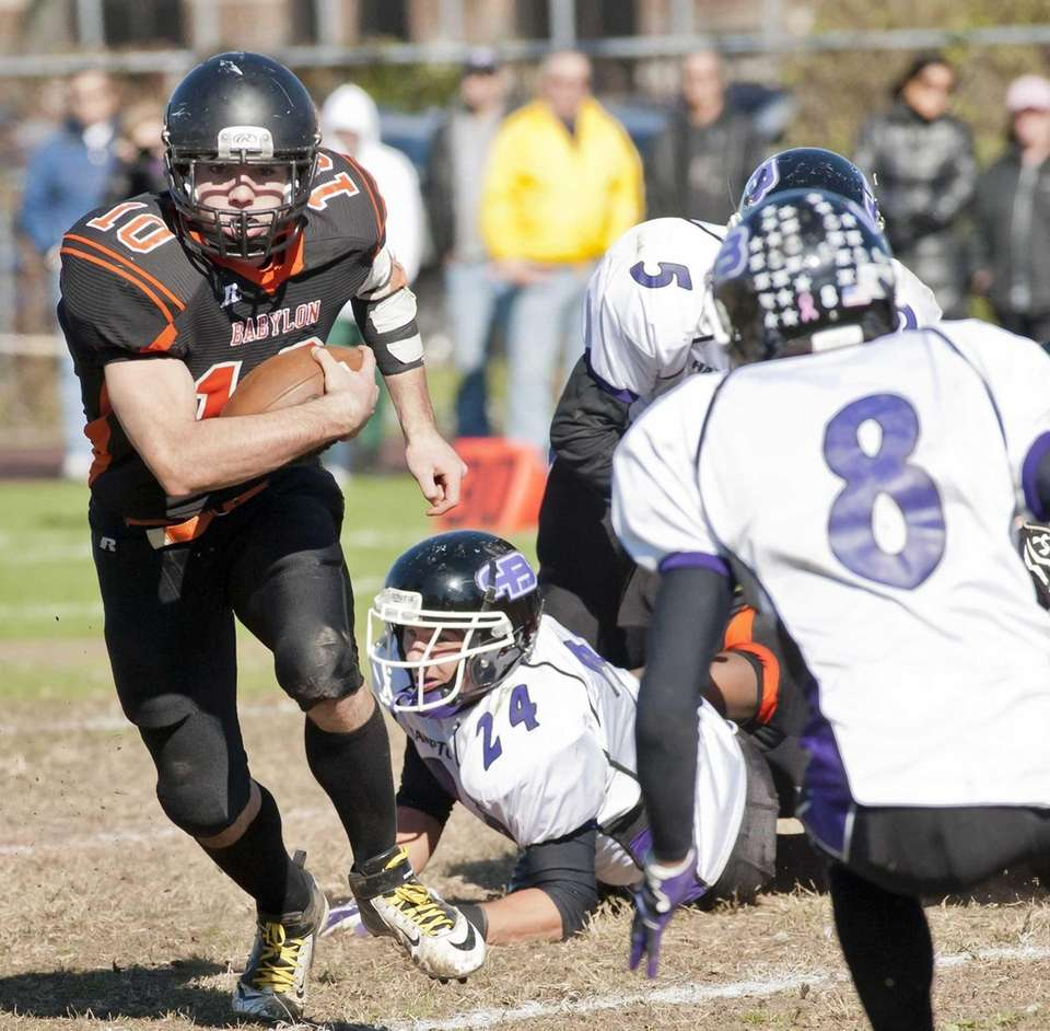 Babylon's Eric Schweitzer gains some yards after breaking