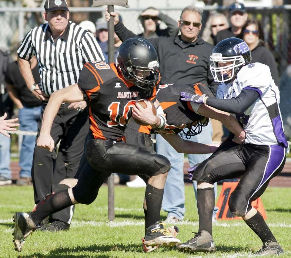 Babylon's running back Eric Schweitzer (10, left), runs