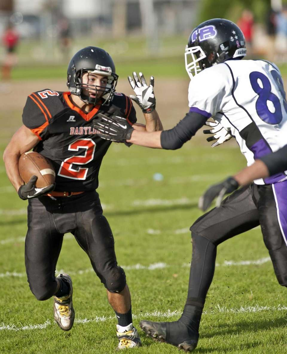 Babylon's running back Luke Zappia (2, left), fights