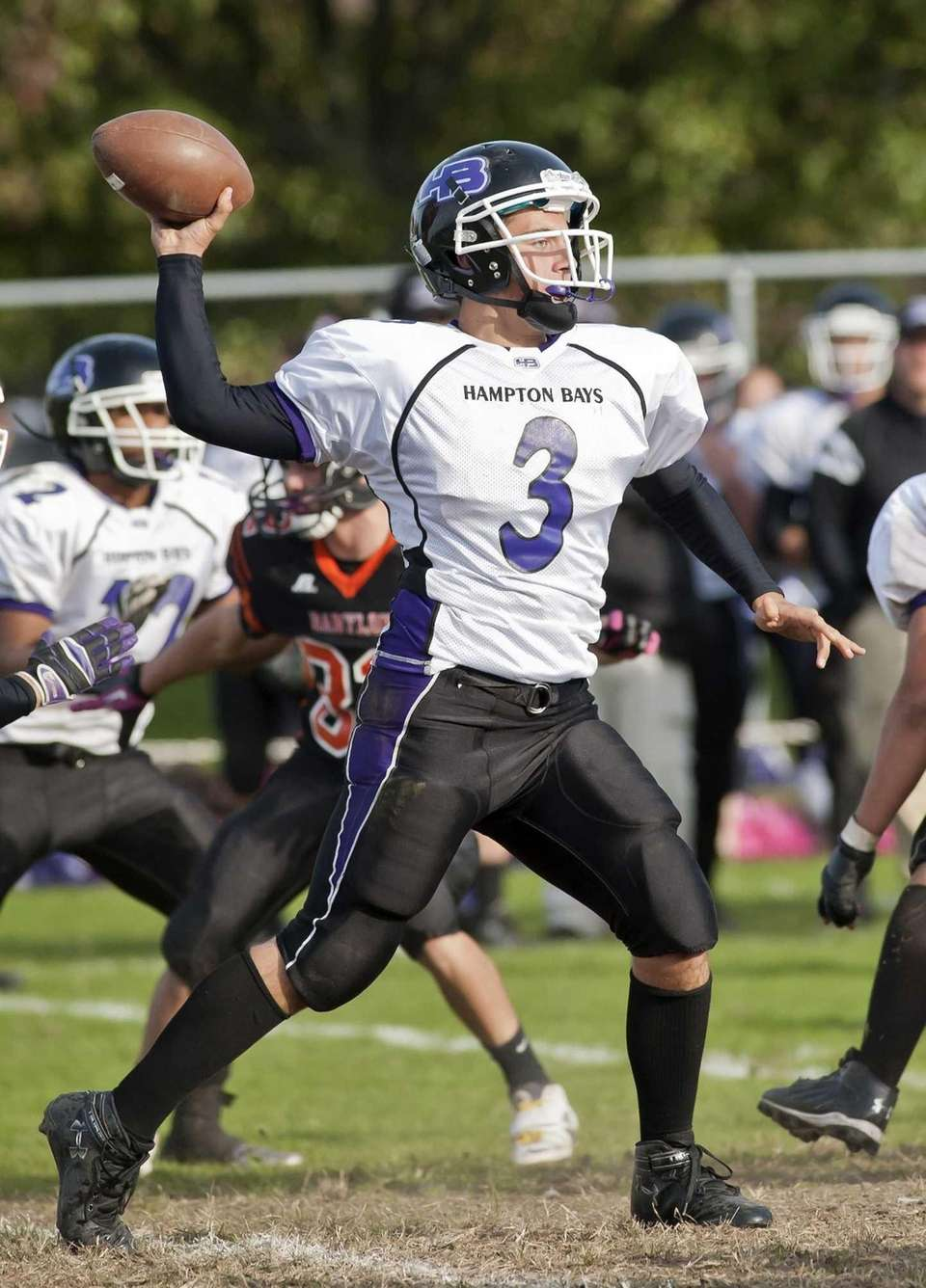 Hampton Bays's quarterback Justin Carbone looks to pass.