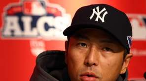 Hiroki Kuroda speaks to the media before Game