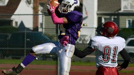 Sewanhaka's Elijah Smith intercepts a pass intended for