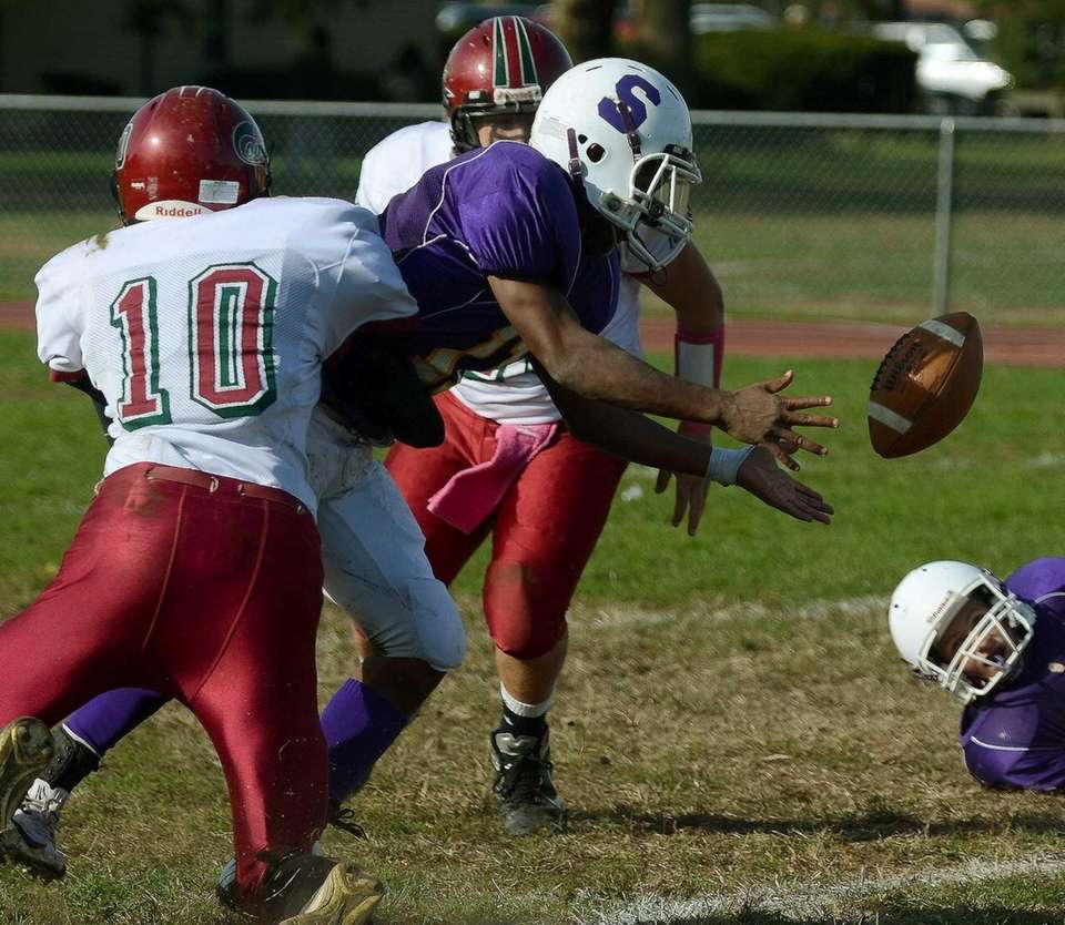 Glen Cove's Chris Klimaszewski tackles Jacquan Johnson as