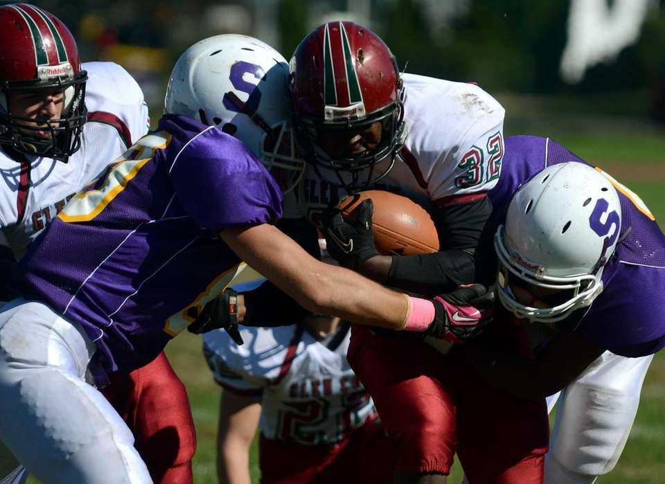 Glen Cove's Ryan Perkins tries to get past